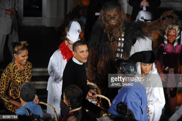 US President Barack Obama and First Lady Michelle Obama greet trick or treaters at the North Portico of the White House as they celebrate Halloween...