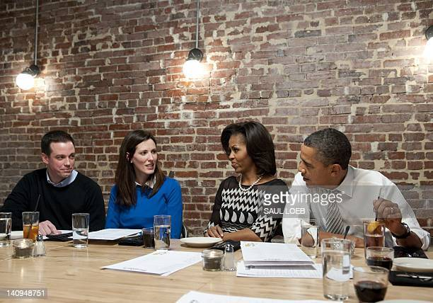 US President Barack Obama and First Lady Michelle Obama have dinner with winners of a Democratic campaign contest including Cathleen Loringer and...