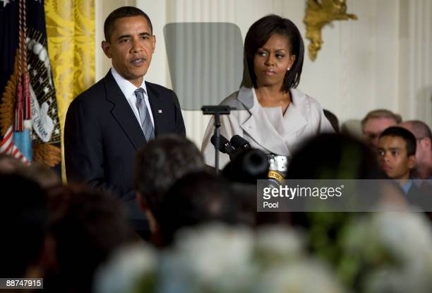 US President Barack Obama and first lady Michelle Obama host a reception for Lesbian Gay Bisexual Transgender Pride Month in the East Room of the...