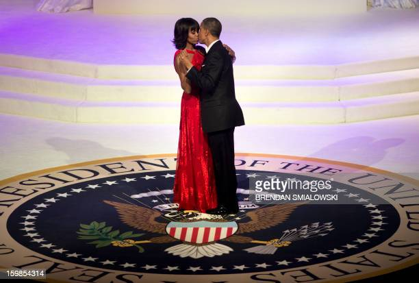 President Barack Obama and First Lady Michelle Obama kiss while dancing at the Commander and Chief Ball at the Washington Convention Center January...