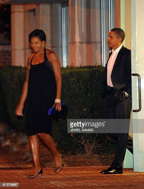 US President Barack Obama and First Lady Michelle Obama leave the Blueduck Tavern restaurant after having dinner in Washington DC on October 3 2009...