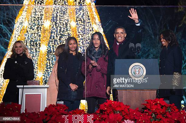 US President Barack Obama and First Lady Michelle Obama light the National Christmas Tree in President's Park outside the White House in Washington...