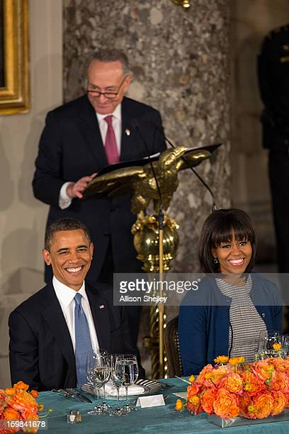 S President Barack Obama and first lady Michelle Obama listen as Sen Charles Schumer Chairman of the Joint Congressional Committee on Inaugural...