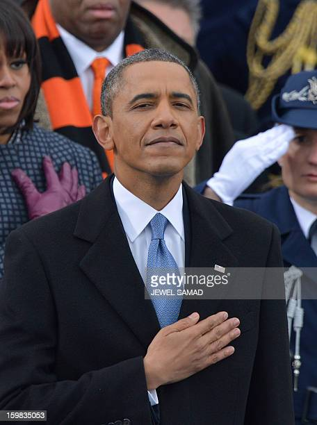 President Barack Obama and First Lady Michelle Obama listen to Beyonce sing the National Anthem during the 57th Presidential Inauguration ceremonial...