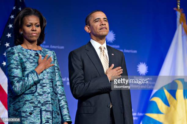 US President Barack Obama and first lady Michelle Obama listen to the national anthem at the groundbreaking ceremony of the Smithsonian National...
