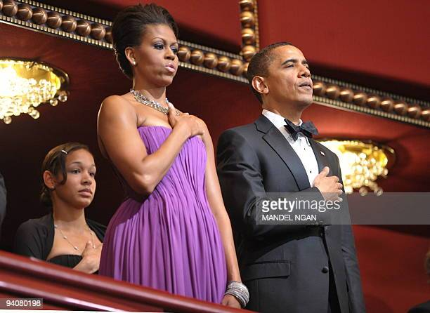 US President Barack Obama and First Lady Michelle Obama listen to the national anthem during the 32nd Annual Kennedy Center Honors December 6 2009 at...