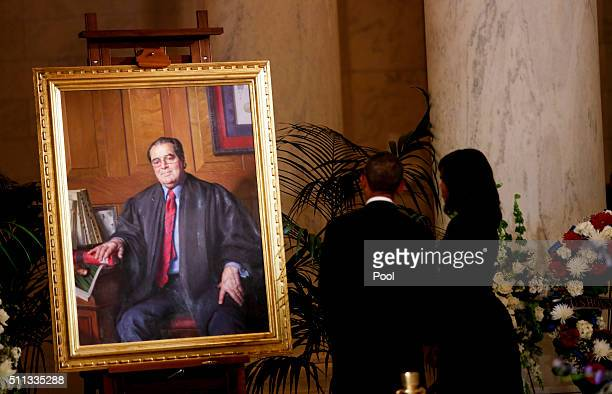 President Barack Obama and First Lady Michelle Obama look at a portrait of Anthony Scalia after paying their respects to Supreme Court Justice...