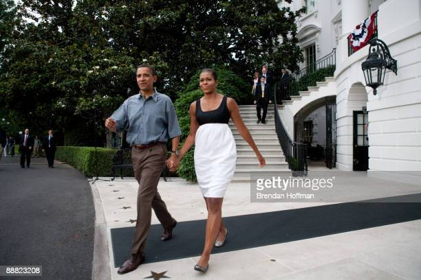 President Barack Obama and First Lady Michelle Obama make their way from White House to shake hands with guests at a gathering of military families...