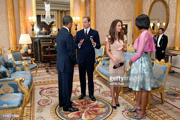 President Barack Obama and First Lady Michelle Obama meet with Prince William Duke of Cambridge and Catherine Duchess of Cambridge at Buckingham...
