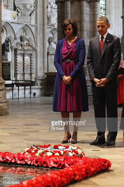 S President Barack Obama and first lady Michelle Obama pay their respects after Mr Obama laid a wreath at the tomb of the Unknown Soldier in...