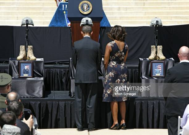 President Barack Obama and first lady Michelle Obama pay their respects in front of the Fallen Soldier memorial for victims of last week's shooting...