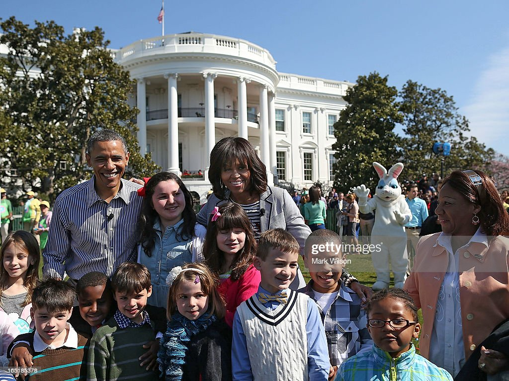 U.S. President Barack Obama and first lady Michelle Obama pose for photos with children during the annual Easter Egg Roll on the White House tennis court April 1, 2013 in Washington, DC. Thousands of people are expected to attend the 134-year-old tradition of rolling colored eggs down the White House lawn that was started by President Rutherford B. Hayes in 1878.