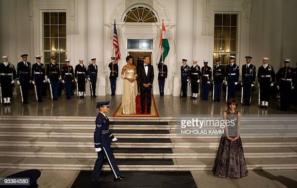 US President Barack Obama and First Lady Michelle Obama prepare to greet Indian President Manmohan Singh and his wife Gursharan Kaur at the North...