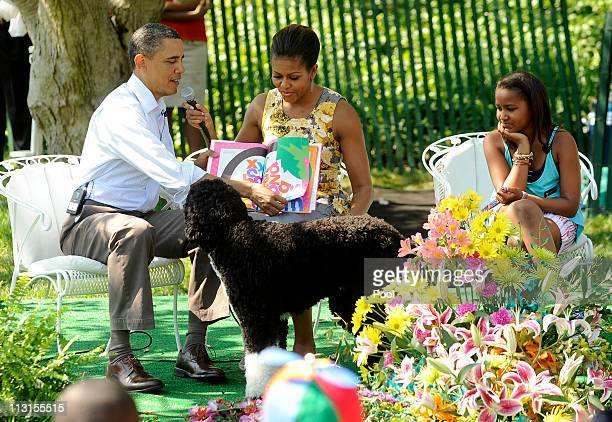 President Barack Obama and first lady Michelle Obama read 'Chicka Chicka Boom Boom' to children during the White House Easter Egg Roll as Sasha Obama...