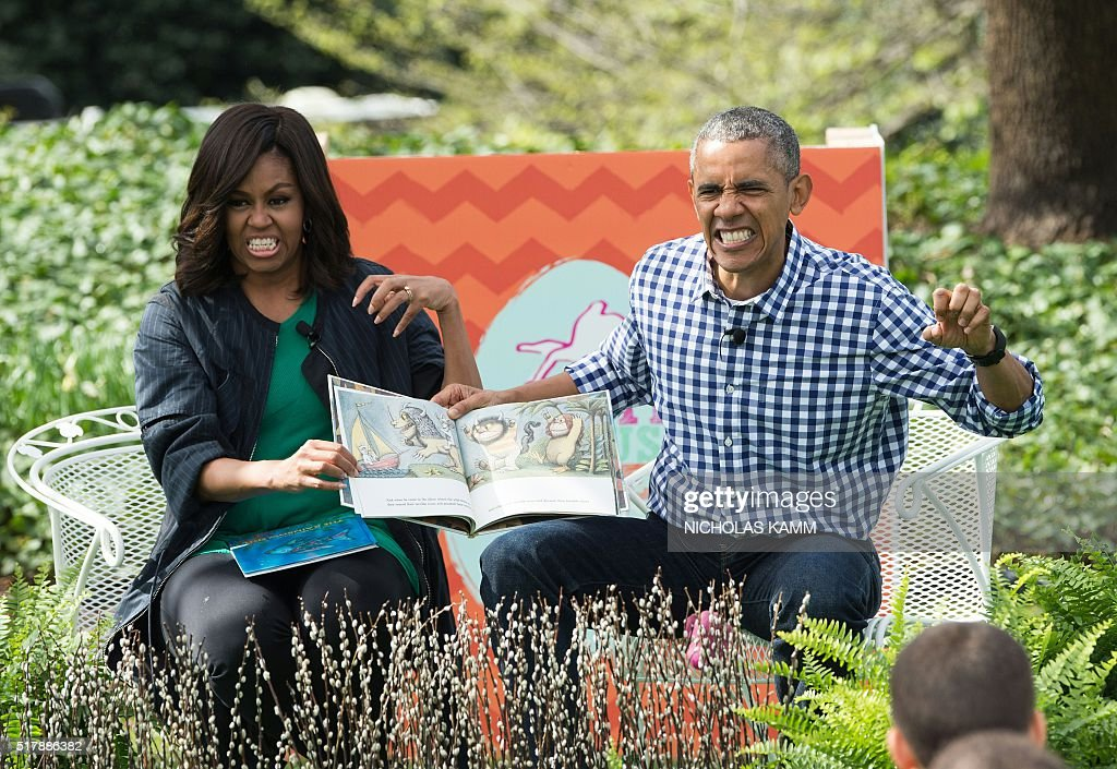 US President Barack Obama and First Lady Michelle Obama read Maurice Sendak's 'Where the Wild Things Are' to children at the annual Easter Egg Roll at the White House in Washington, DC, on March 28, 2016. Some 35,000 guests have been invited to participate in the 138th annual Easter Egg roll. The theme of the day's event is Let's Celebrate! / AFP / Nicholas Kamm