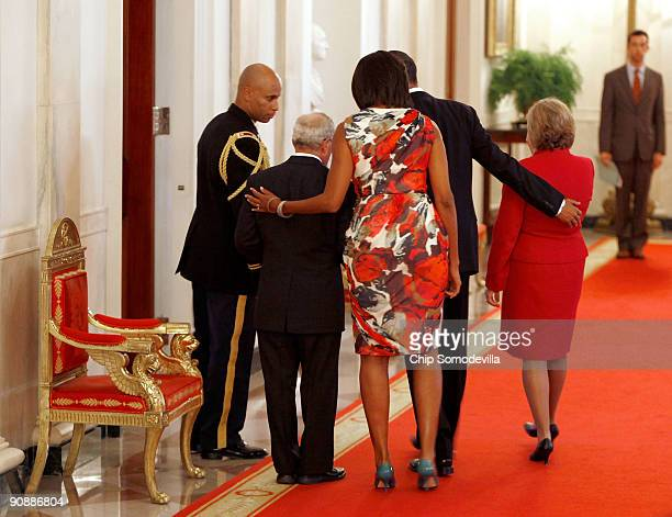 S President Barack Obama and first lady Michelle Obama return to the Blue Room with Paul and Janet Monti after presenting the Medal of Honor...