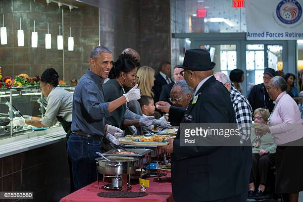 President Barack Obama and First Lady Michelle Obama serve Thanksgiving dinner to residents at the Armed Forces Retirement Home on November 23 2016...