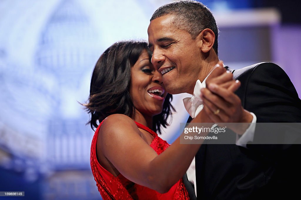 U.S. President Barack Obama and first lady Michelle Obama sing together as they dance during the Inaugural Ball at the Walter Washington Convention Center January 21, 2013 in Washington, DC. Obama was sworn-in for his second term of office earlier in the day.
