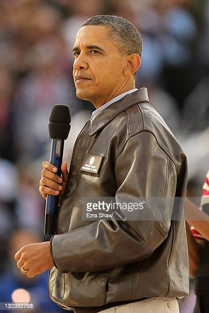 President Barack Obama and first lady Michelle Obama speak to the crowd before the start of the NCAA men's college basketball Carrier Classic between...
