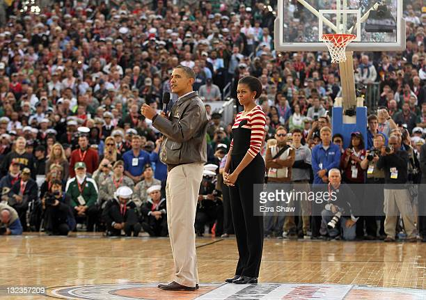 S President Barack Obama and first lady Michelle Obama speak to the crowd before the start of the NCAA men's college basketball Carrier Classic...