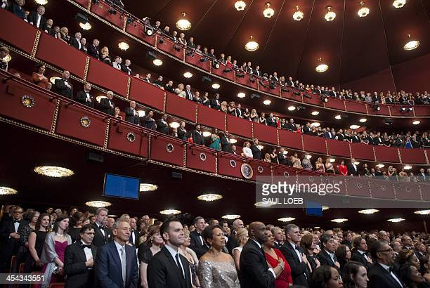 US President Barack Obama and First Lady Michelle Obama stand alongside the Kennedy Center Honorees for the national anthem as they attend the 2013...
