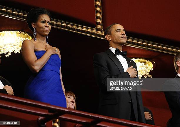 US President Barack Obama and First Lady Michelle Obama stand as the national anthem is played during the Kennedy Center Honors event at the Kennedy...