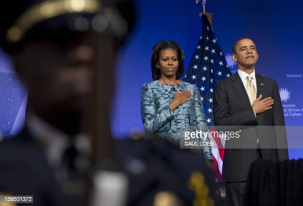US President Barack Obama and First Lady Michelle Obama stand for the National Anthem during the groundbreaking ceremony for the Smithsonian National...