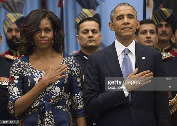 US President Barack Obama and First Lady Michelle Obama stand for the American National Anthem prior to participating in a receiving line before a...