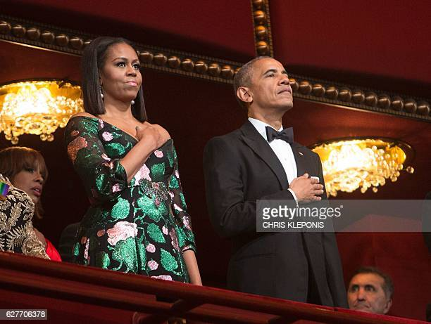 US President Barack Obama and First Lady Michelle Obama stand for the National Anthem during the 2016 Kennedy Center Honors at the Kennedy Center on...