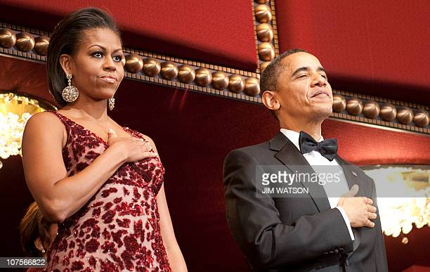 US President Barack Obama and First Lady Michelle Obama stand for the US National Anthem during the Kennedy Center Honors in Washington DC December 5...