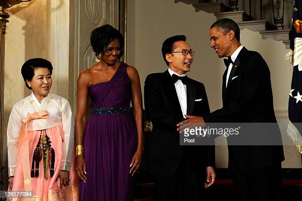 US President Barack Obama and first lady Michelle Obama stand with South Korean President Lee Myungbak and Lee's wife Kim Yoonok in the Cross Hall as...