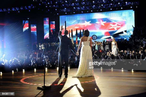 US President Barack Obama and First Lady Michelle Obama take the stage while pop singer Beyonce seranades them during the first Inaugural Ball of the...