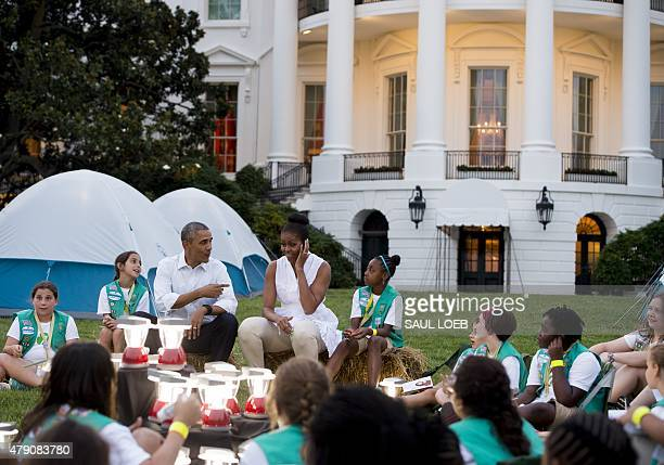 US President Barack Obama and First Lady Michelle Obama talk with Girl Scouts who will camp overnight on the South Lawn of the White House in...