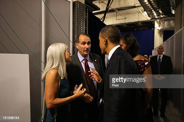 US President Barack Obama and First Lady Michelle Obama talk with senior campaign advisor David Axelrod following Obama's speech at the Democratic...