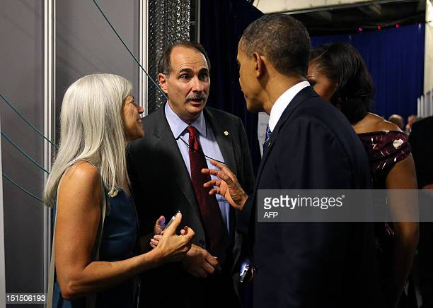 US President Barack Obama and First Lady Michelle Obama talk with senior campaign adviser David Axelrod and his wife Susan backstage following...