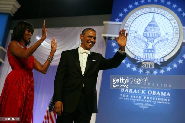 President Barack Obama and first lady Michelle Obama thank supporters during the Commander in Chief Inaugural Ball at the Walter E. Washington...