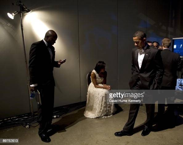 President Barack Obama and First Lady Michelle Obama wait ...