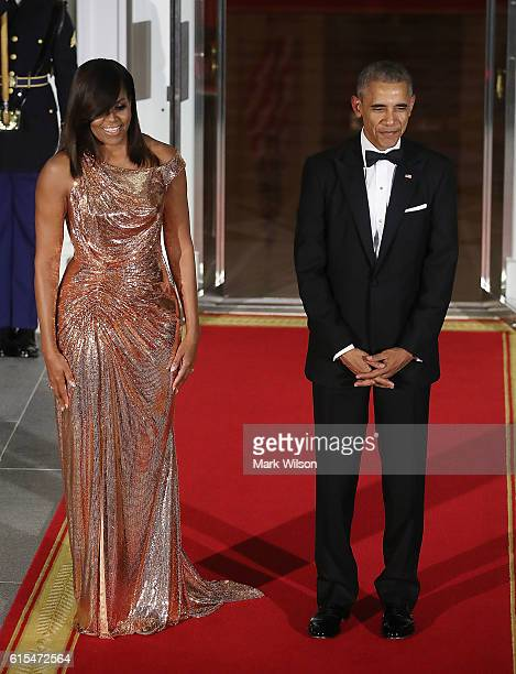 S President Barack Obama and first lady Michelle Obama wait for the arrival of Italian Prime Minister Matteo Renzi and his wife Mrs Agnese Landini...
