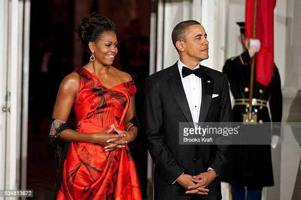 President Barack Obama and first lady Michelle Obama wait to greet Chinese President Hu Jintao for a state dinner at the White House in Washington