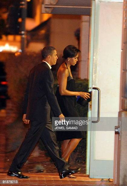 US President Barack Obama and First Lady Michelle Obama walk in a restaurant for their anniversary dinner in Washington DC on October 3 2009 AFP...