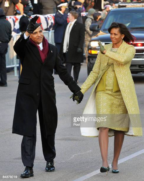 President Barack Obama and first lady Michelle Obama walk in the Inaugural Parade on January 20, 2009 in Washington, DC. Obama was sworn in as the...