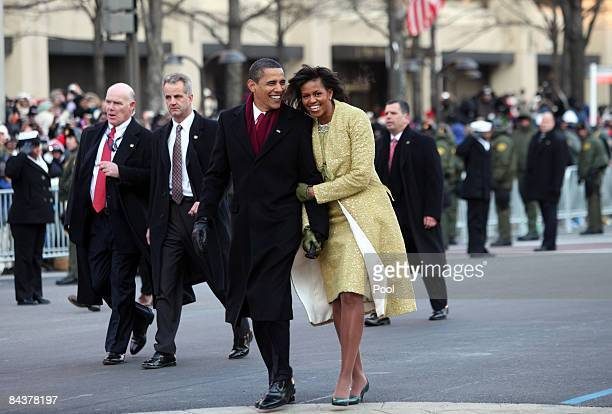 President Barack Obama and first lady Michelle Obama walk in the inaugural parade following his inauguration as the 44th President of the United...