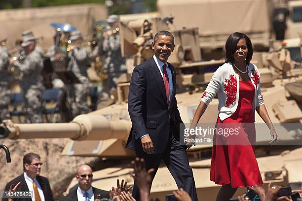 S President Barack Obama and first lady Michelle Obama walk on stage at Fort Stewart army base on April 27 2012 in Hinesville Georgia This is Obama's...