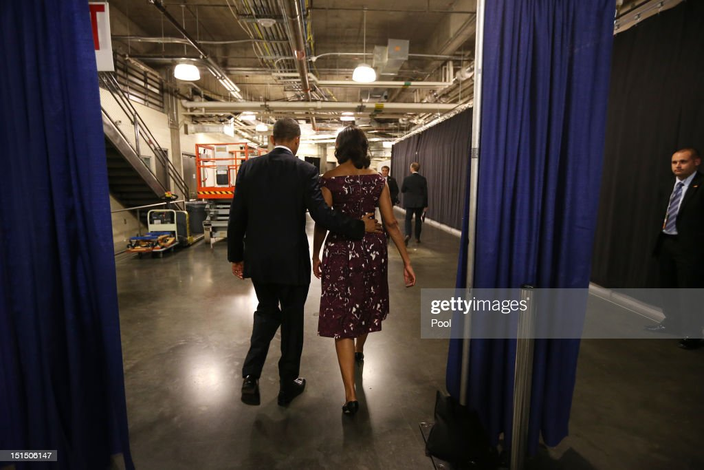 U.S. President Barack Obama and First Lady Michelle Obama walk to their car following President Obama's speech at the Democratic National Convention at Time Warner Cable Arena on September 6, 2012 in Charlotte, North Carolina. The DNC nominated U.S. President Barack Obama as the Democratic presidential candidate.