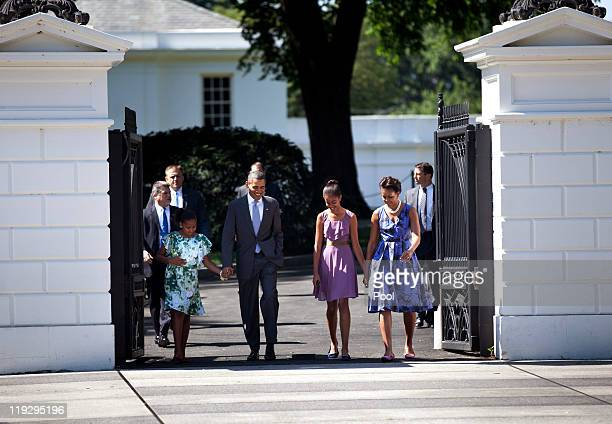 US President Barack Obama and first lady Michelle Obama walk with their daughters Sasha and Malia from the White House to St John's Protestant...