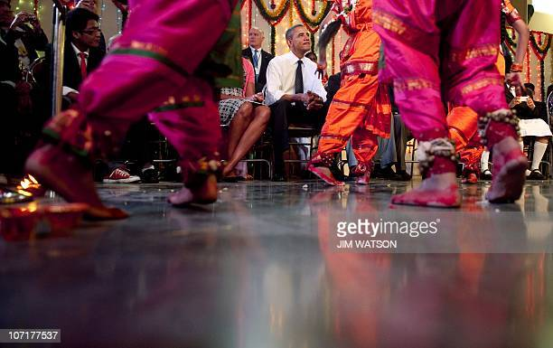 US President Barack Obama and First Lady Michelle Obama watch a cultural event at The Holy Name High School in Mumbai on November 7 2010 Barack...