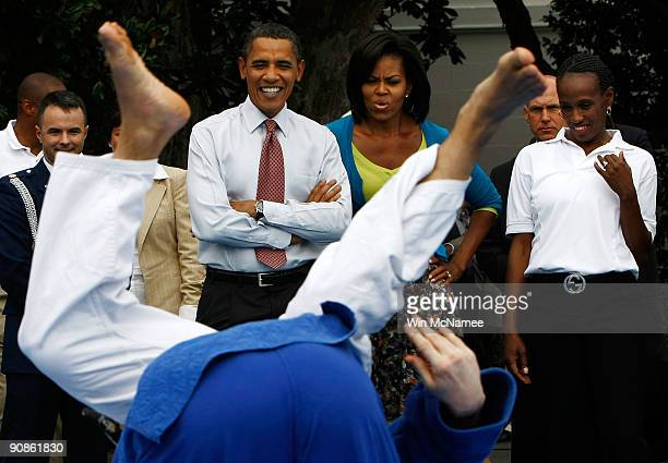 President Barack Obama and first lady Michelle Obama watch a judo demonstration during an event on the South Lawn of the White House promoting the...