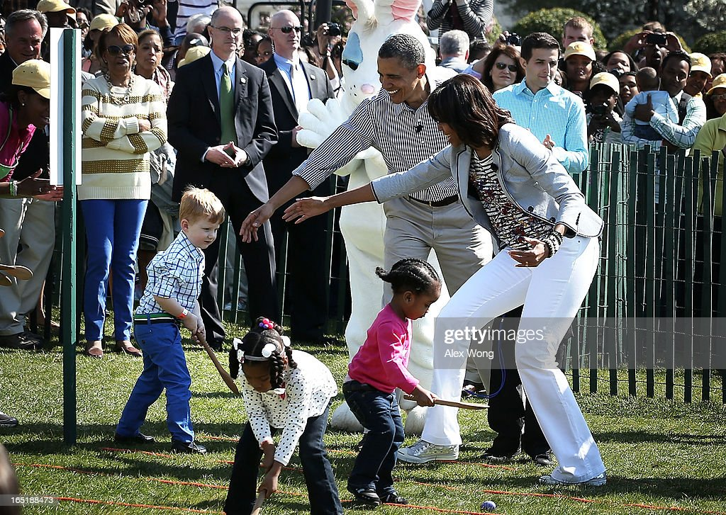 U.S. President Barack Obama (2nd R) and first lady Michelle Obama (R) watch as children participate during the annual White House Easter Egg Roll on the South Lawn of the White House April 1, 2013 in Washington, DC. President Obama and first lady Michelle Obama hosted thousands of people during the annual celebration of Easter.