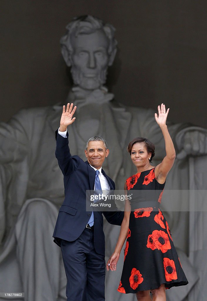 U.S. President Barack Obama (L) and first lady Michelle Obama wave as they leave at the end of the Let Freedom Ring ceremony at the Lincoln Memorial August 28, 2013 in Washington, DC. The event was to commemorate the 50th anniversary of Dr. Martin Luther King Jr.'s 'I Have a Dream' speech and the March on Washington for Jobs and Freedom.