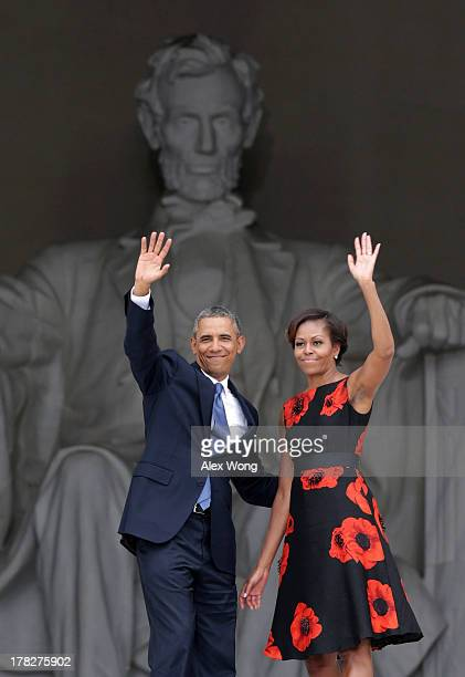 S President Barack Obama and first lady Michelle Obama wave as they leave at the end of the Let Freedom Ring ceremony at the Lincoln Memorial August...